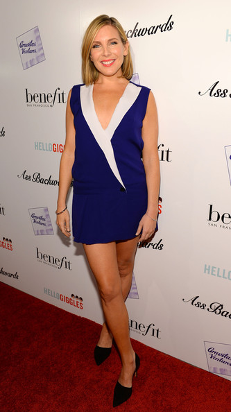 June Diane Raphael showed plenty of skin at the 'Ass Backwards' premiere in a sleeveless blue and white blazer dress with a plunging neckline.