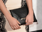 Nathalie Emmanuel opted for this cool leather envelope clutch for her red carpet look at the 'Game of Thrones' season 3 premiere.