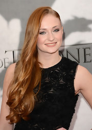 Sophie Turner showed off her gorgeous red locks with long waves pinned to one side for an extra retro-glam vibe.