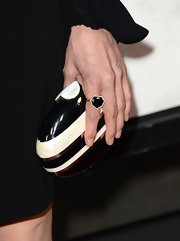 Michelle Forbes chose a cool hard case clutch with geometric designs for her red carpet look.