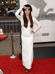 Oona Chaplin showed off her slender frame with this long-sleeve white dress.