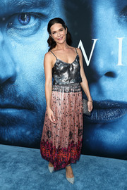 Katie Aselton went boho on the bottom half in a mixed-print maxi skirt.