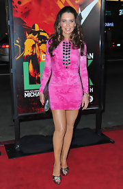 Sandra topped off her bright pink mini dress with metallic platform sandals.