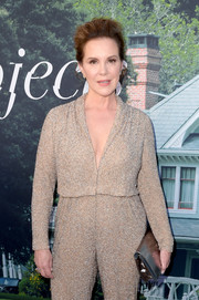 Elizabeth Perkins paired a silver clutch with a sparkling gold jumpsuit for the premiere of 'Sharp Objects.'