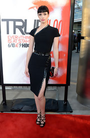 Krysten Ritter looked like a chic dominatrix in this slashed leather-adorned LBD.