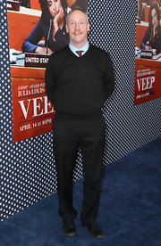 Matt Walsh chose a basic black V-neck sweater to pair over a tie and button down for a preppy and classic look.