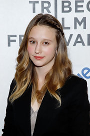 Taissa Farmiga styled her honey-hued tresses in soft curls. She accented her look with a cute side braid.