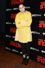 Minnie Driver teamed her cute coat with black capris.