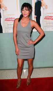 Jessica steps out at the 'Love, Wedding, Marriage' premiere in a gray racer back tank dress.
