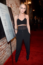 Kristen Stewart paired her top with black corset pants by Sally LaPointe.