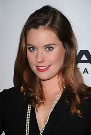 Her healthy looking waves made Ashley William's simple wrap-dress glamorous enough for the Image Entertainment event.