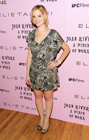 Dreama Walker showed off her chiffon print dress while attending Joan Rivers A Piece of Work premiere.