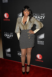 Jennifer Hudson showed off her hourglass figure with a leopard print top and polka dot skirt.