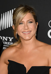 Jennifer Aniston kept her beauty look simple with a nude lip gloss.