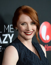 Bryce Dallas Howard chose a deep blood red lip stain to bring out the red of her hair.