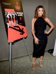 Eva Longoria donned a simple yet sexy halterneck LBD for the premiere of 'Devious Maids' season 4.