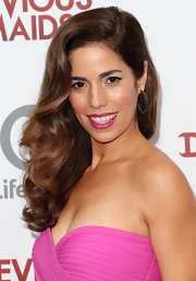 Ana Ortiz chose a hot pink lip color to complement her pink cocktail dress at the 'Devious Maids' premiere.