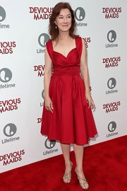 Valerie Mahaffey sported a vibrant ruby red dress with a full circle skirt.