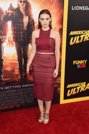 Holland Roden worked an uber-cool vibe at the 'American Ultra' premiere in this geometric red Self-Portrait crop-top rendered in vertical and horizontal mesh stripes.