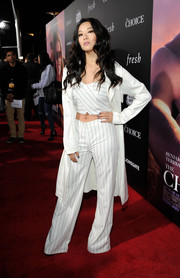 Arden Cho teamed a pinstripe crop-top with a white coat for the premiere of 'The Choice.'