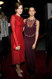 Teresa Palmer flashed some cleavage in an embellished burgundy mesh-yoke gown by Prada at the premiere of 'The Choice.'