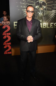 Jean-Claude Van Damme wore an elegant black suit and a purple button-down shirt to the 'Expendables 2' premiere.