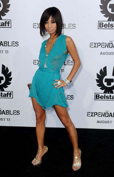 Bai Ling hit the red carpet sporting a sheer cocktail dress with embellished evening sandals.
