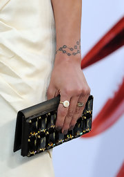 Charisma paired her cream dress with a gemstone inlaid clutch.