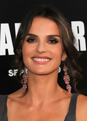 Ana Alexander's eyes were smoldering at the 'Warrior' premier. To try creating the look at home, start with a product like L'Oreal Studio Secrets One Sweep Eyeshadow Trio. Start by smudging the deepest shade along the lash line, blending the medium shade along the upper lid and into the crease and adding the lightest shade to the inner corners of eyes and under the brow bone.