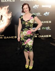 Brooke Bundy wore this romantic floral sheath dress to the LA premiere of 'The Hunger Games.'.