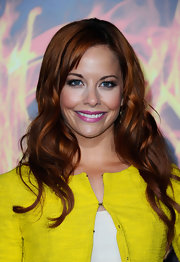 Amy Paffrath attended the premiere of 'The Hunger Games' wearing her hair in long tumbled curls.