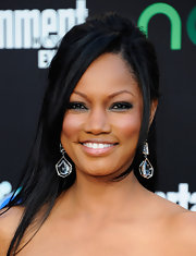 Garcelle Beauvais attended 'The Hunger Games' premiere wearing a sexy smoky-eyed look along with soft rosy cheeks and nude lipstick.