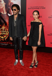 Zoe Kravitz hit the red carpet wearing a Balenciaga off-the-shoulder LBD during the 'Catching Fire' premiere in LA.