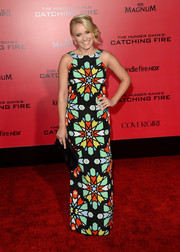 Emily Osment went for a vibrant retro look with this colorful geometric-print column dress by Mara Hoffman during the 'Catching Fire' LA premiere.