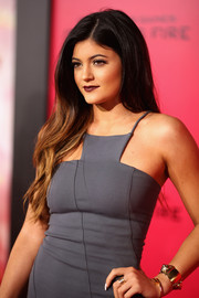Kylie Jenner attended the premiere of 'The Hunger Games: Catching Fire' wearing a chunky gold cuff.