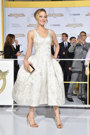 Jennifer Lawrence styled her dress with a rose-gold clutch by Roger Vivier.