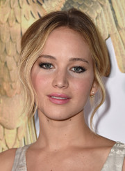Jennifer Lawrence amped up the ultra-feminine allure with a pink lip.