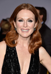 Julianne Moore attended the 'Hunger Games: Mockingjay Part 1' premiere sporting a center-parted hairstyle with sculpted waves down the ends.