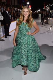 Willow Shields opted for silver strappy sandals by Stuart Weitzman to style her gown.
