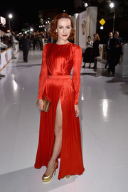Jena Malone's gold Charlotte Olympia slingbacks paired beautifully with her red gown.