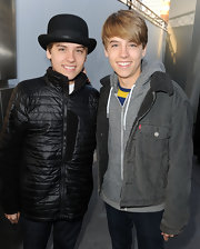 Dylan Sprouse adds another bowler hat to his collection, this time in ebony.