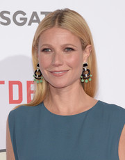 Gwyneth Paltrow dolled up her plain hairstyle with a pair of statement earrings by David Webb.