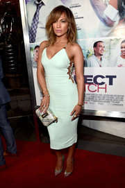 Jennifer Lopez pulled her look together with a striped metallic clutch by Valentino.