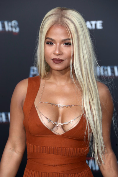 Christina Milian blinged up her assets with a silver body chain by 21HM.