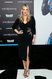 Molly Sims complemented her dress with a pair of black T-strap sandals by Jimmy Choo.