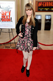 Debby Ryan kept warm at the premiere of 'The Spy Next Door' in black leather ankle boots worn with white opaque tights.