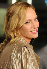 Uma Thurman opted for a casual hairstyle at the premeire of 'Ceremony.' A long braid complete with loose face framing curls completed her look.