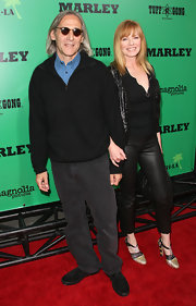 Marg Helgenberger arrived at the 'Marley' premiere wearing a tri-colored pair of woven pumps featuring T-straps and chunky heels.