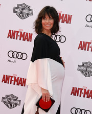 Evangeline Lilly paired a red and black Les Petits Joueurs box clutch with a monochrome gown for the 'Ant-Man' premiere.