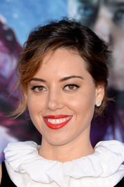 Aubrey Plaza swiped on some rich red lipstick for a striking pop of color to her look.